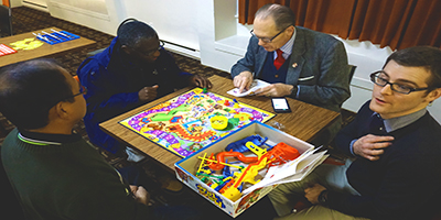 a group of people playing a board game